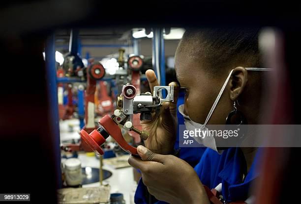 A woman looks at jewels as the president of the Republic of Botswana Lieutenant General Seretse Khama Ian Khama officially inaugurates the Shrenuj...