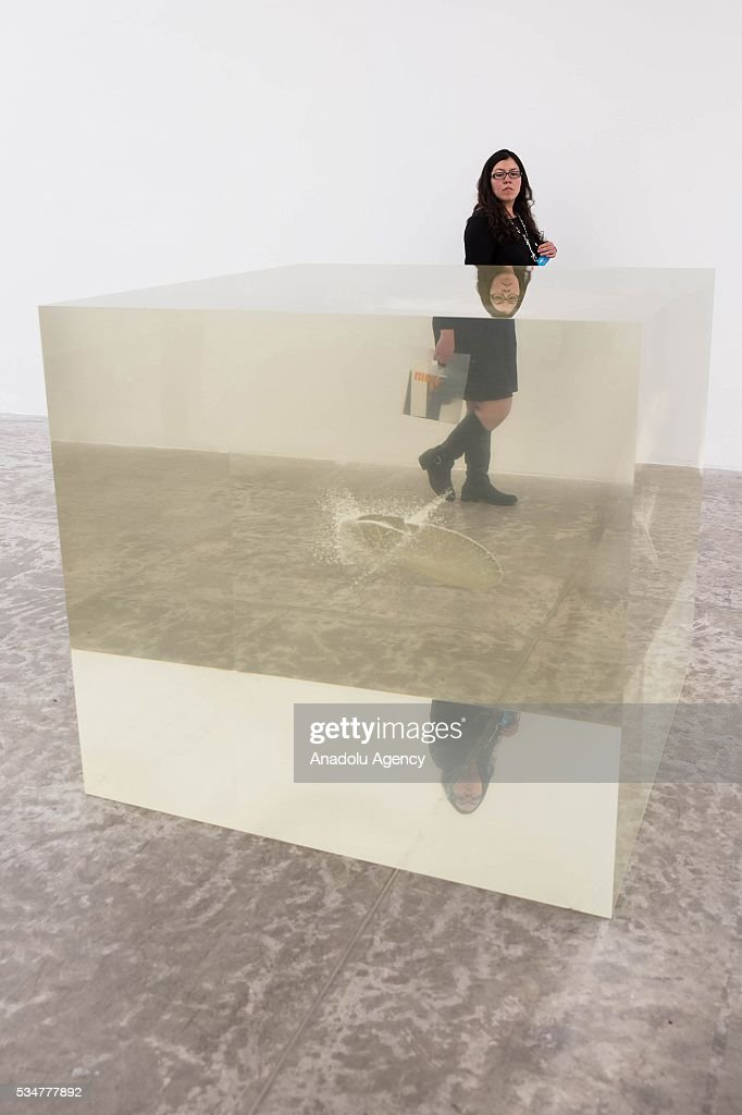 A woman looks at 'Laboratory for a New Model of the Universe' by Indian-British sculptor Anish Kapoor during the exhibition press preview of 'Archaeology: Biology' at University Museum of Contemporary Art in Mexico City, Mexico on May 27, 2016. This exhibition offers a wide-ranging perspective on Kapoors workwith sculptures dating from 1980 to 2016.