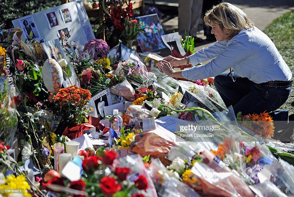 A woman looks at large makeshift memorial for Steve Jobs at Apple headquarters on October 7, 2011 in Cupertino, California. Jobs, who died October 5, 2011 at the age of 56, co-founded Apple in 1976 and is credited with marketing the world's first personal computer in addition to the popular iPod, iPhone and iPad.