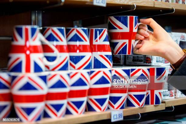 A woman looks at merchandise for sale in a souvenir shop on Whitehall in London on October 22 2017 Britain could be left 'poorer and weaker' by...