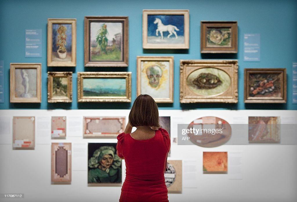 A woman looks at paintings of dutch painter Vincent van Gogh in the Van Gogh Museum in Amsterdam The Netherlands June 21 2011 The museum discovered a...