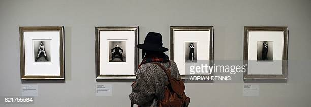 A woman looks at photographs by Irving Penn during a press preview of the forthcoming exhibition entitled 'The Radical Eye Modernist Photography from...