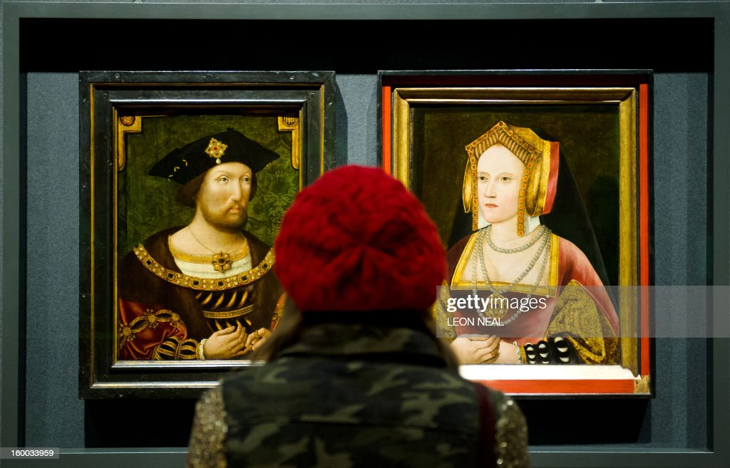 A woman looks at portraits of English King Henry VIII and his first wife Catherine of Aragon displayed together for the first time in nearly 500 years, at the National Portrait Gallery, central London, on January 25, 2013. Discovered in Lambeth Palace, the portrait of Catherine of Aragon had been painted over with a picture of the King's last wife Catherine Parr but experts suspected that there may be more to the picture due to similarities with other known paintings of Catherine of Aragon. After work by the National Portrait Gallery's restoration team, the painting is being displayed in the 'Henry and Catherine Reunited' exhibition from January 25, 2013. AFP PHOTO/LEON NEAL