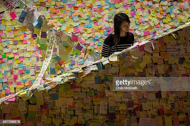 A woman looks at prodemocracy notes stuck to a stairwell outside Hong Kong's Government complex on October 16 2014 in Hong Kong Hong Kong Police have...
