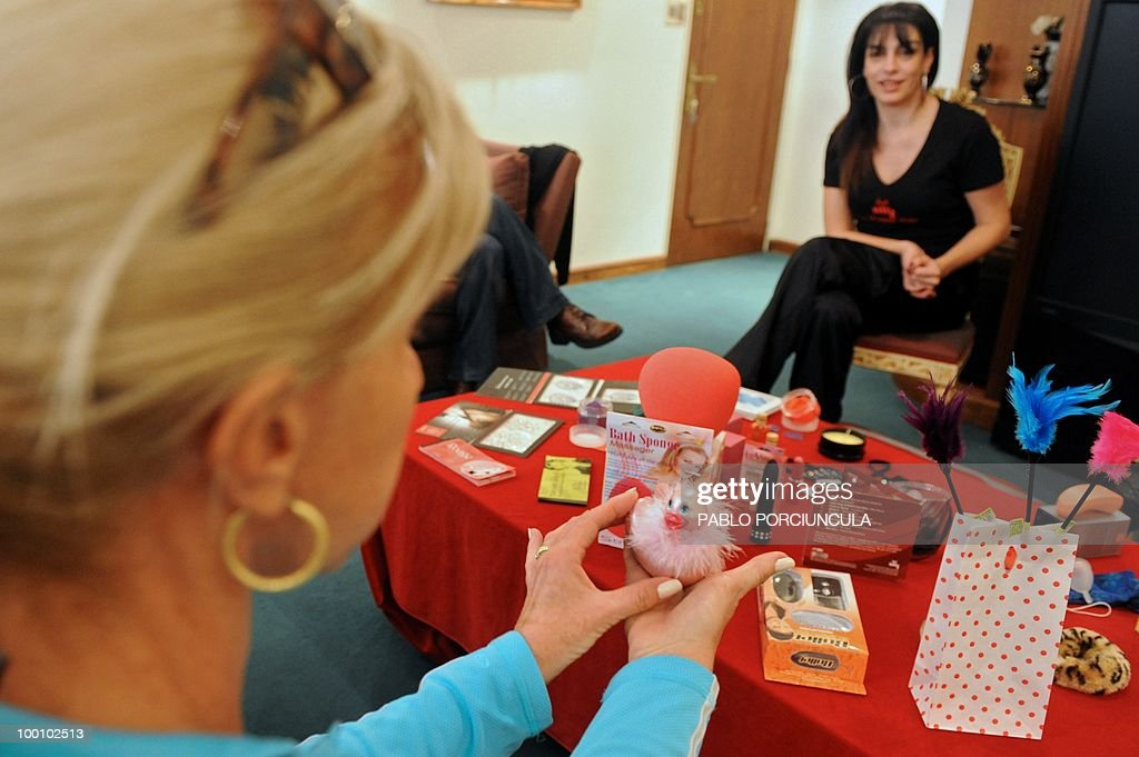 A woman looks at products of 'La Maleta Roja' (The Red Suitcase) company, in Montevideo, Uruguay, on May 15, 2010. The Spanish company, specializing in erotic toys, lingerie and cosmetics, sells its products through saleswomen who go to friends meetings at homes. AFP PHOTO/Pablo PORCIUNCULA