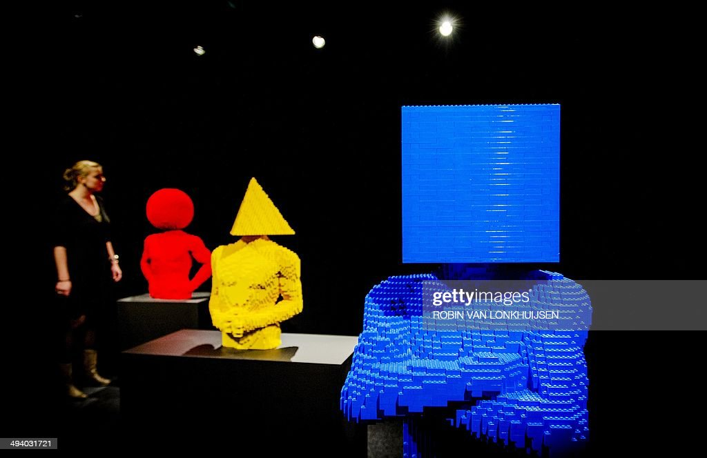 A woman looks at sculptures made out of Lego bricks by New York-based artist Nathan Sawaya, on display during the exhibition 'The Art of Brick' held at the Amsterdam EXPO in Amsterdam, the Netherlands, on May 27, 2014. The exhibition by New York-based artist Nathan Sawaya presents more than 70 artworks open to the public as of May 29, 2014.