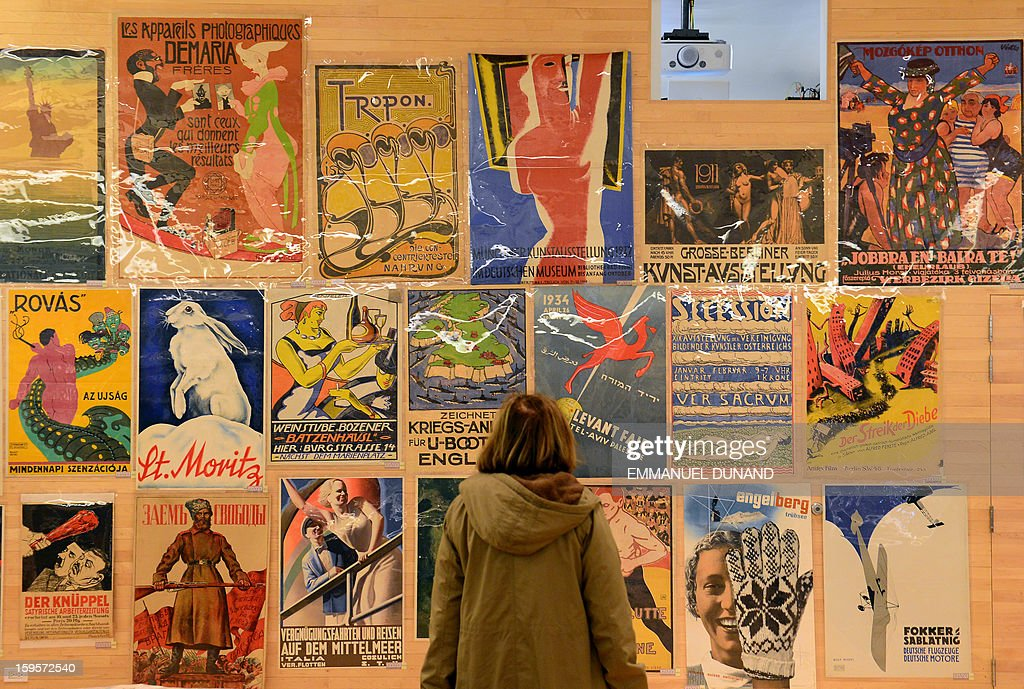 A woman looks at some of the collection of more than 4,300 pre-World War II posters, looted by the Gestapo during the WWII, is on display prior to be auctioned at the National Bohemian Hall in New York, January 16, 2013. A German court ordered the German Historical Museum, where the posters were kept, to return the collection, gathered by Hans Sachs, a Jewish dentist who fled Nazi Germany, to Hans' son Peter Sachs. The collection will be auctioned on January 18, 2013 with an estimated value at more than 5.8 million USD.