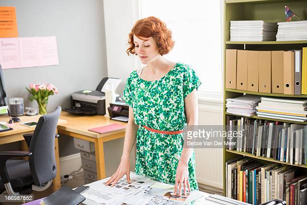 Woman looks at storyboards in  home office