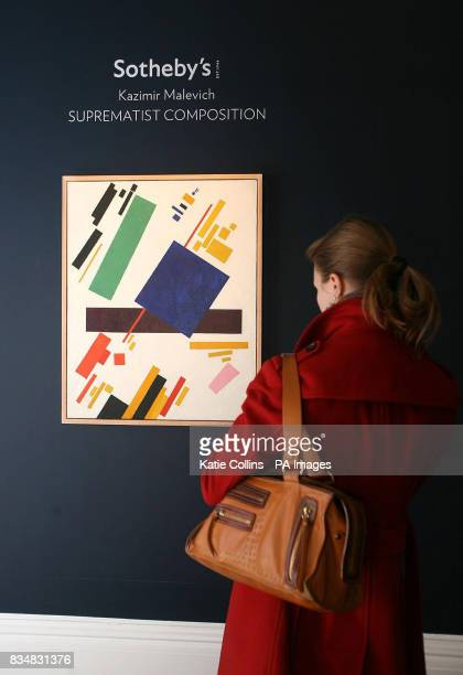 A woman looks at 'Suprematist Composition' by Kazimir Malevich on display at Sotheby's in London The painting is expected to fetch in excess of $60...