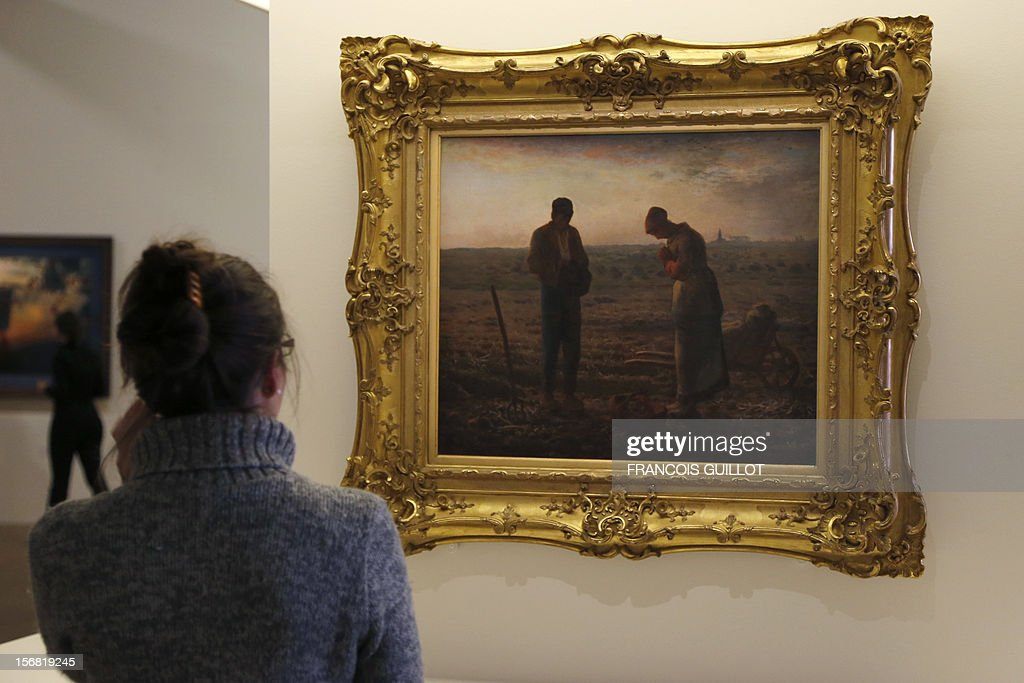 A woman looks at the 'Angelus' painting by Jean-François Millet displayed by during an exhibition devoted to the work Spanish surrealist artist Salvador Dali at the Centre Pompidou art center (aka Beaubourg) on November 19, 2012 in Paris. More than 30 years after the first retrospective in 1979, the event gathers more than 200 art pieces and runs until March 13, 2013.