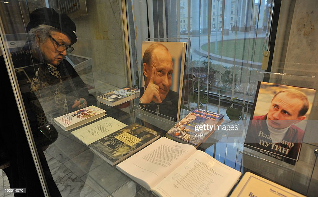 A woman looks at the books with photos of Russia's President Vladimir Putin on their covers, which are displayed at an exhibition marking Putin's 60th anniversary in Saint-Petersburg on October 6, 2012. The Russian strongman turns 60 tomorrow.