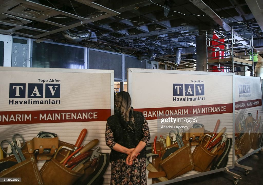 A woman looks at the damaged area as the maintenance continue at the international arrivals terminal at the Ataturk International Airport after the air traffic returned to normal following yesterday's terror attack in Istanbul, Turkey on June 29, 2016. At least 36 victims and three suicide bombers were killed while scores of others were injured in a terror attack on Istanbuls Ataturk International Airport.