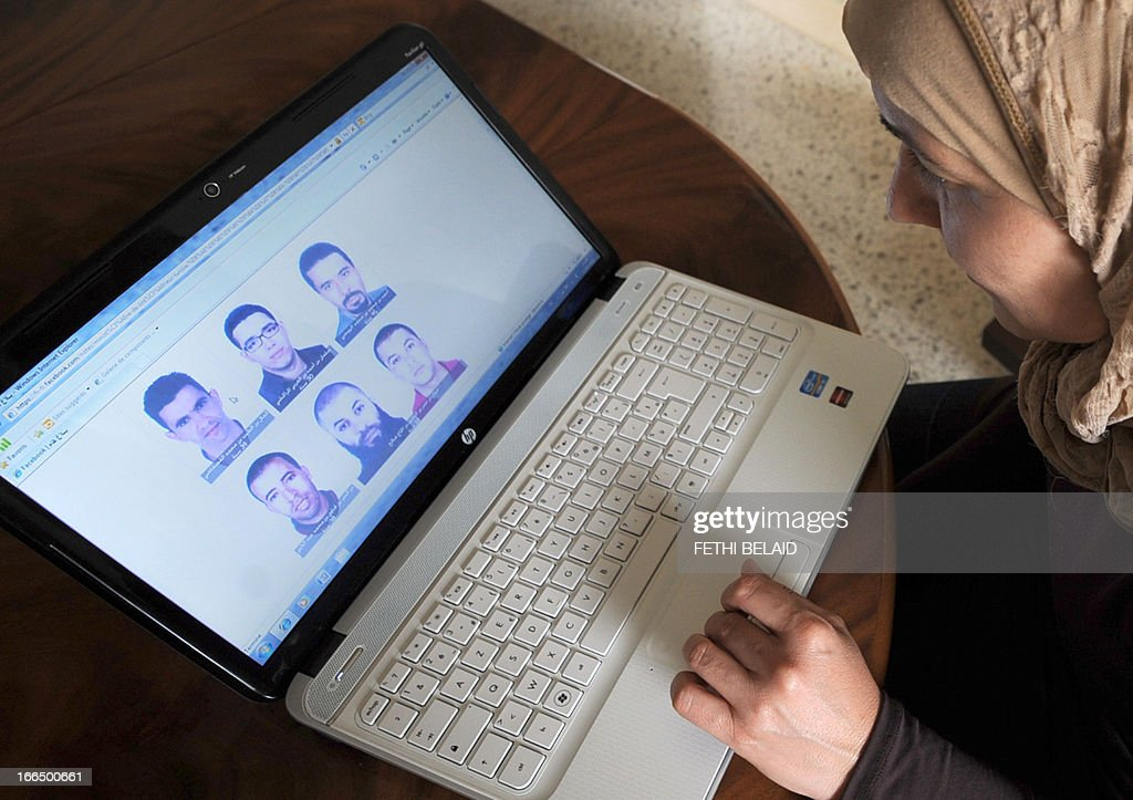 A woman looks at the facebook page of Tunisia's interior ministry on which are published the photos of five Islamists wanted for the assassination in February of secular opposition politician Chokri Belaid on April 13, 2013 in Tunis. In a statement on its page, the ministry published photos of Kamel Gathgathi, 39, the alleged shooter (topL). Wanted as accomplices are Ahmed Rouissi, 46, Salmane Marakchi, 30, Marouane Ben Haj Salah, 33, and Ezzedine Abdelaoui, 38.