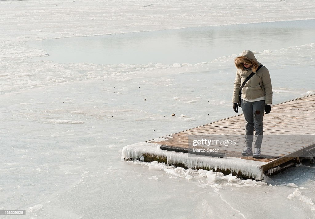 A woman looks at the frozen Venice Lagoon on February 5, 2012 in Venice, Italy. Italy as most of Europe is under a spell of very cold weather, it is more than 20 years since the Venice Lagoon had last been frozen.