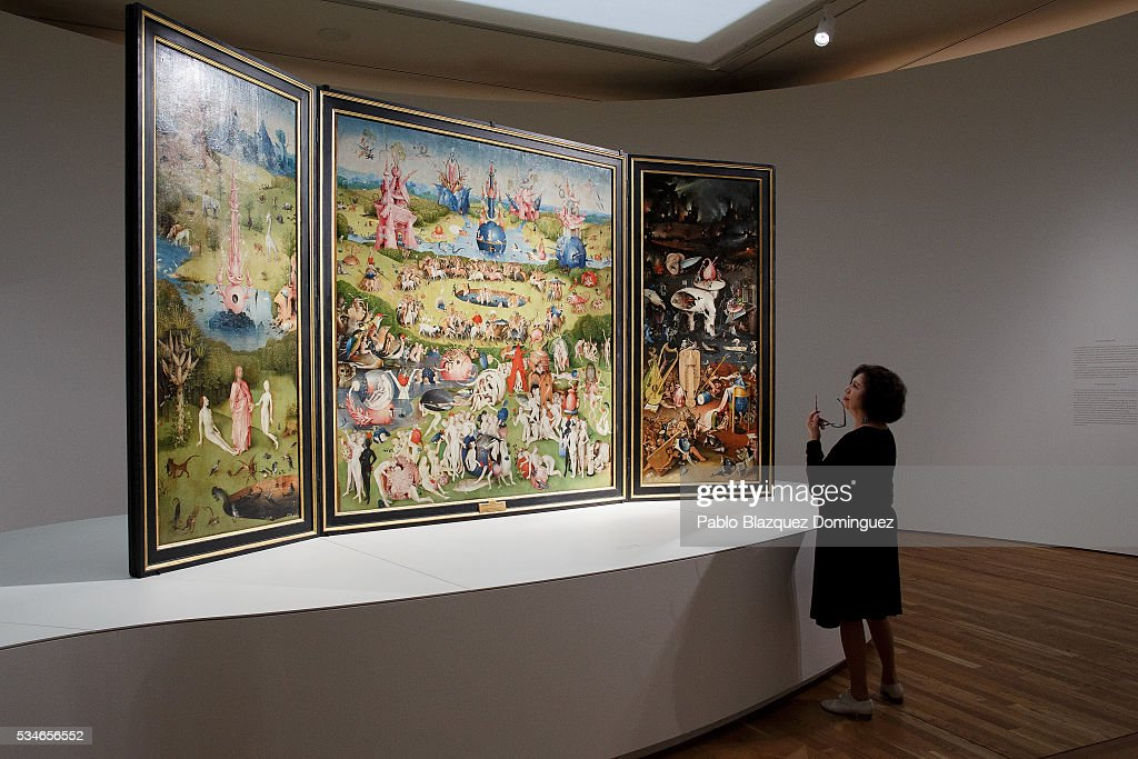A woman looks at 'The garden of earthly delights triptych' from Dutch painter Hieronymus Bosch during a press preview at El Prado Museum on May 27, 2016 in Madrid, Spain. The Prado Museum holds the 'El Bosco' (Hieronymus Bosch) painter major exhibition to celebrate the fifth century anniversary of the Dutch artist's death (ca. 1450-1516) featuring sixty five works from various Spanish and global museums.
