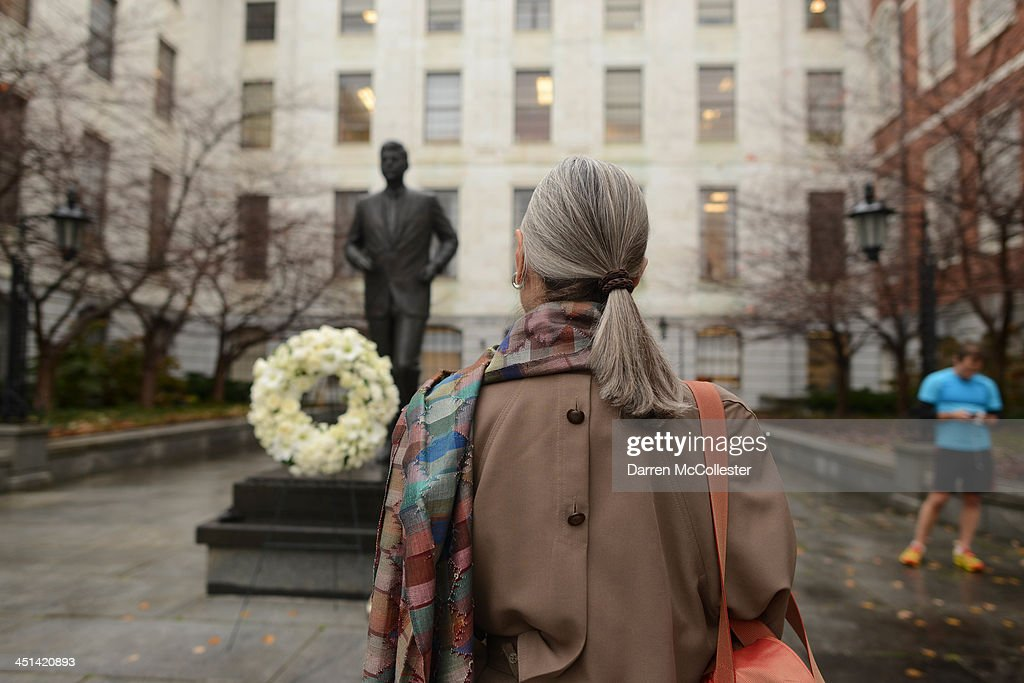 A woman looks at the John F. Kennedy statue at the State House November 22, 2013 in Boston, Massachusetts. Kennedy, born in Brookline Massachusetts, was killed 50 years ago on this day by Lee Harvey Oswald in Dallas Texas in 1963.