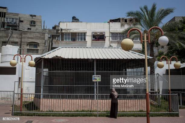 A woman looks at the lion enclosure at the Jabalia Zoo on July 20 2017 in Gaza City Gaza For the past ten years Gaza residents have lived with...