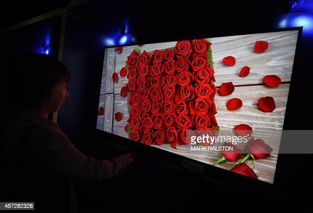 A woman looks at the new Panasonic 4K Ultra HD LED TV on display at the Luxury Technology Show in Beverly Hills on October 15 2014 4K televisions...