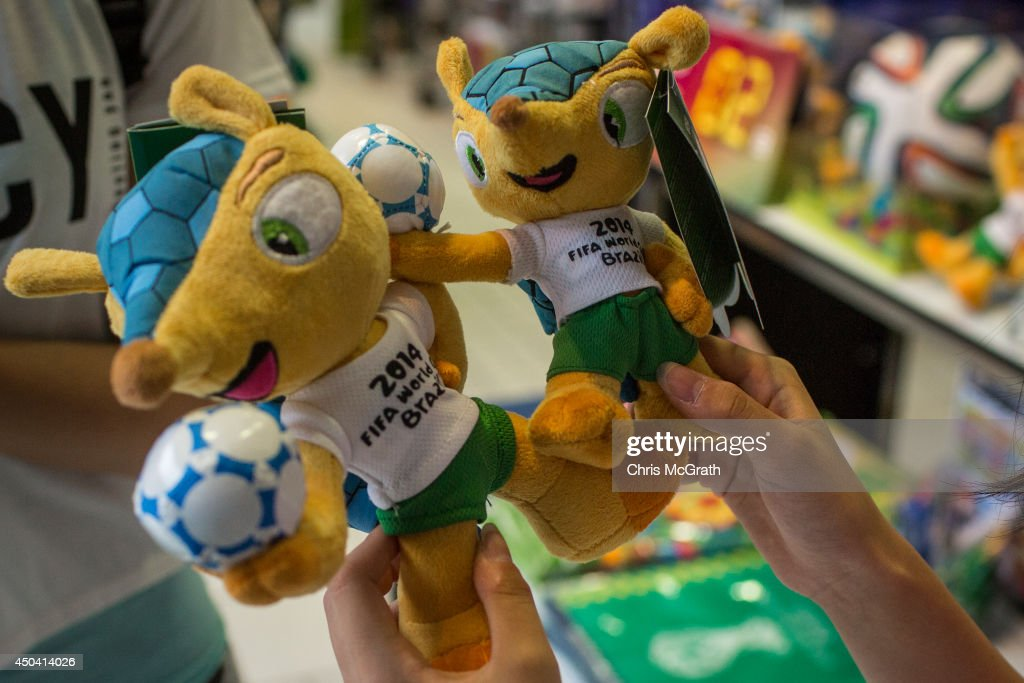 A woman looks at the official FIFA World Cup 2014 mascot at a football store on June 11, 2014 in Tokyo, Japan. The World Cup 2014 in Brazil will begin on June 12th with the first match between Brazil and Croatia.
