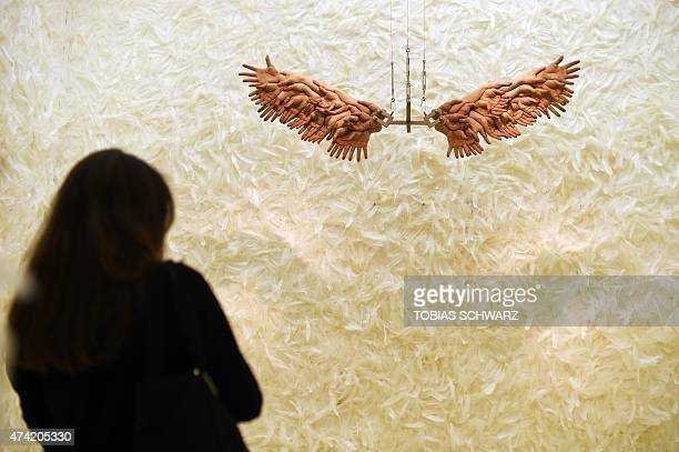 A woman looks at the piece 'The Wings' by artist Xooang Choi during the press presentation of their exhibition Obedience An Art Installation in 15...