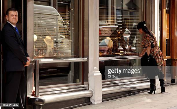 A woman looks at the window display in a jewelers on New Bond Street in Mayfair which is the most expensive avenue in Europe for retail rents on...