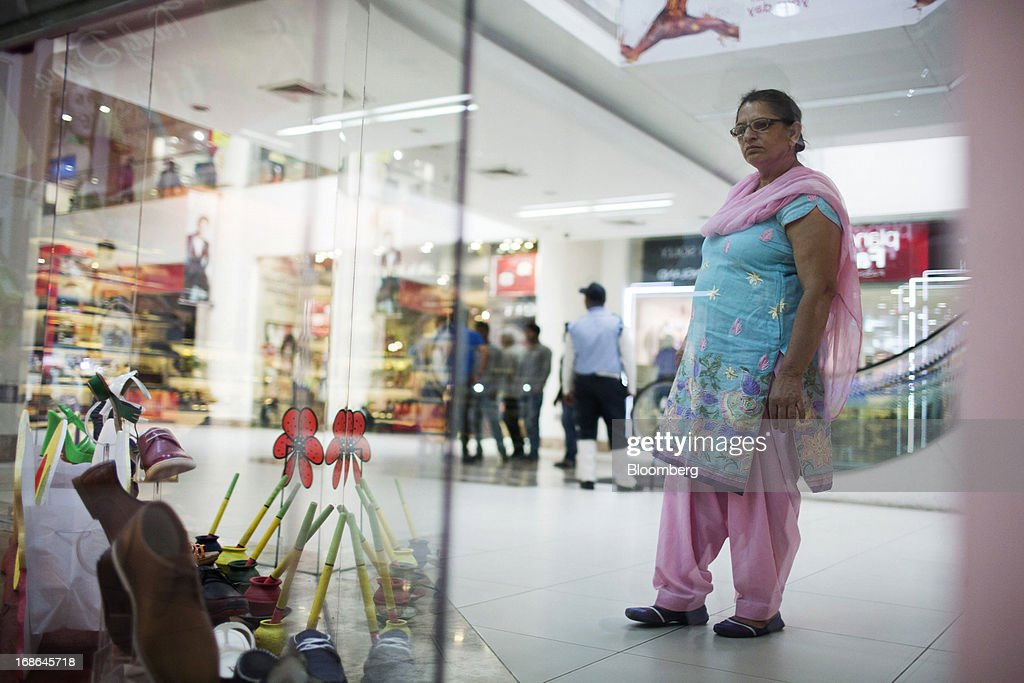 A woman looks at the window display of a shoe store at the AlphaOne shopping mall in Amritsar, India, on Thursday, May 9, 2013. India's consumer price index (CPI) for April rose 9.39 percent year on year, the Central Statistics Office said in a statement on its website. Photographer: Brent Lewin/Bloomberg via Getty Images