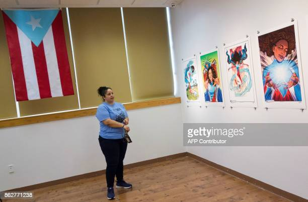 A woman looks at the work of Edgardo MirandaRodriguez writer and creator of the bestselling graphic novel La Borinquena at the Casita Maria Center...