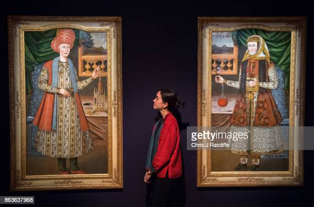 A woman looks at two seventeenthcentury Safavid oil portraits during a press call for the India Islamic Exhibition at Sotheby's on October 20 2017 in...