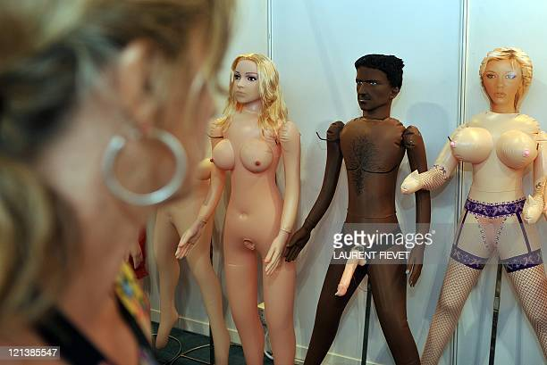 A woman looks at various sex dolls on during the Asia Adult Expo at the Venetian Convention Centre in Macau on August 19 2011 The fourth Asia Adult...