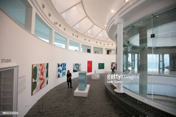 A woman looks at works from the Tate collection in the newly rehung galleries in the interior of the Tate St Ives which is set to reopen to the...
