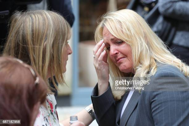 A woman looks emotional after police avacuated the Arndale Centre on May 23 2017 in Manchester England An explosion occurred last night at Manchester...