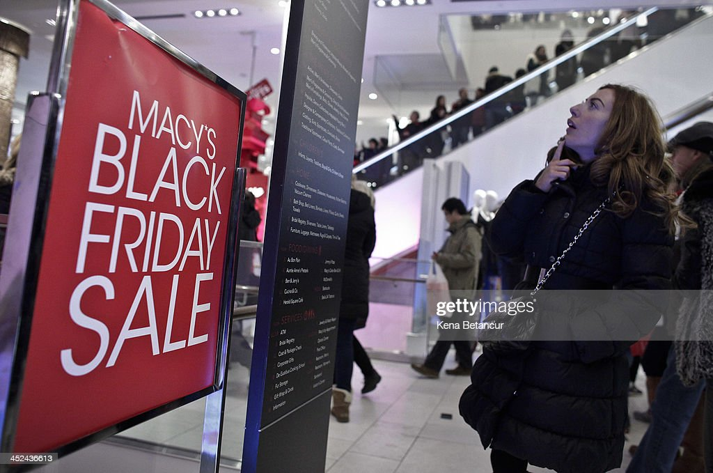 A woman looks for information at Macy's Herald Square after the store opened its doors at 8 pm Thanksgiving day on November 28, 2013 in New York City. Black Friday shopping began early again this year with most major retailers opening their doors on Thanksgiving day.