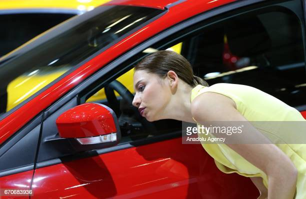 A woman looks herself from wing mirror of Hyundai i30 during the Istanbul Autoshow 2017 at the TUYAP Fair and Convention Center in Istanbul Turkey on...