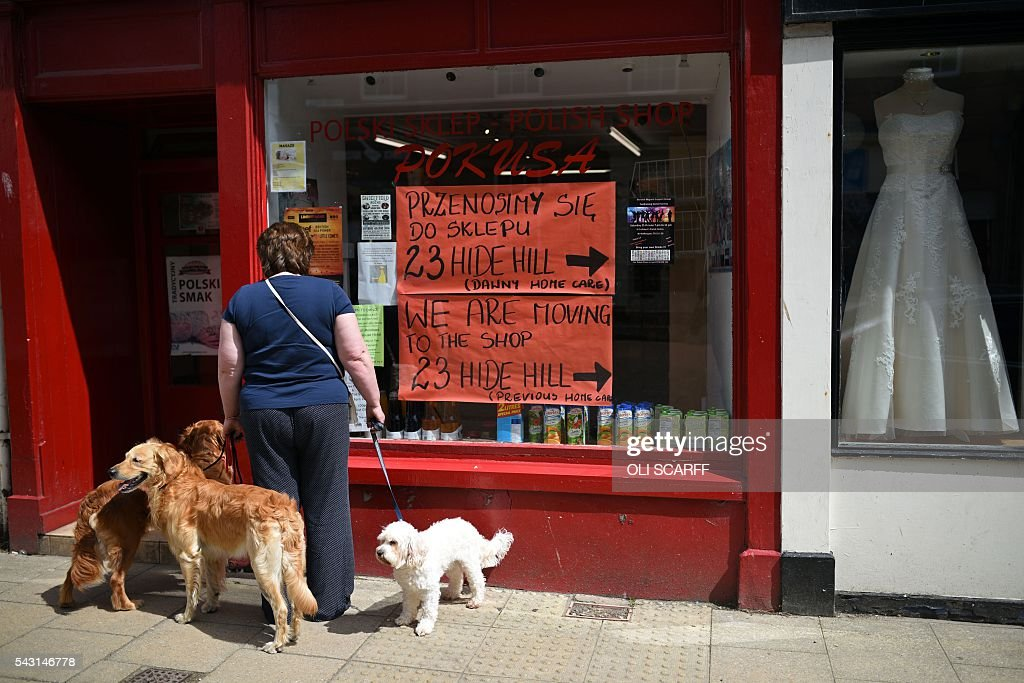 A woman looks in the window of a Polish shop in the centre of the border town of Berwick-upon-Tweed in northern England close to the border between England and Scotland on June 26, 2016. Scotland's First Minister Nicola Sturgeon campaigned strongly for Britain to remain in the EU, but the vote to leave has given the Scottish National Party leader a fresh shot at securing independence. Sturgeon predicted more than a year ago that a British vote to leave the alliance would give pro-European Scots cause to hold a second referendum on breaking with the UK. SCARFF
