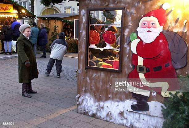A woman looks into a hat shop at a Christmas Market December 23 2001 near Stuttgart Germany Thousands flock to the Christmas markets at this time of...