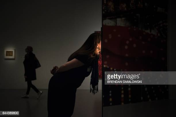 A woman looks into the Love Forever room during a preview of the Yayoi Kusama's Infinity Mirrors exhibit at the Hirshhorn Museum February 21 2017 in...