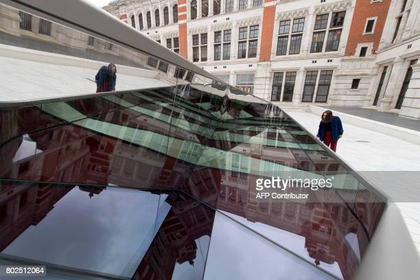 A woman looks into the new exhbition space below the Sackler Courtyard a new addition to the Victoria and Albert museum as it is unveiled to the...