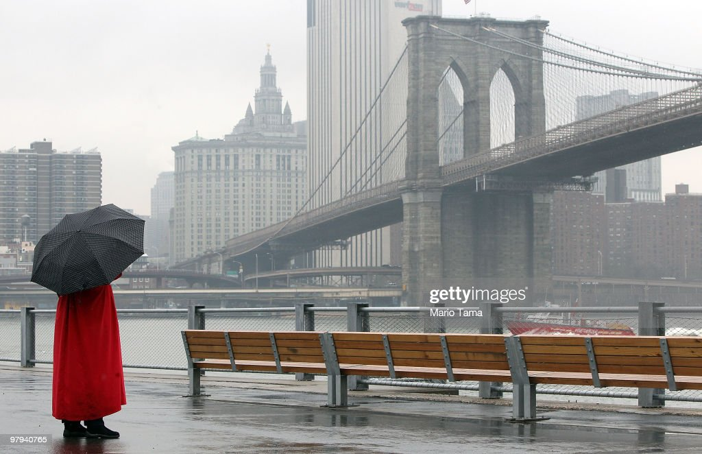 A woman looks on after a ribboncutting ceremony for the justopened first section of Brooklyn Bridge Park March 22 2010 in the Brooklyn borough of New...