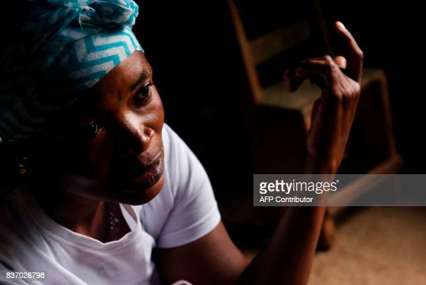 A woman looks on after attending a mass celebrated in the Royal Kings International school in Freetown on August 20 2017 A week after Sierra Leone's...