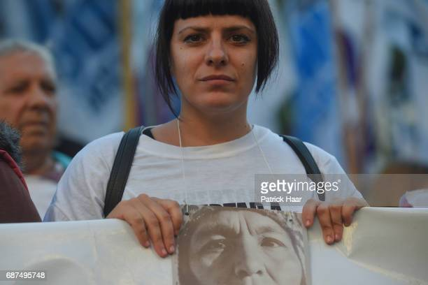 A woman looks on and holds a banner with the face of Milagro Sala as part of a demonstration to demand freedom for the leader of Tupac Amaru...