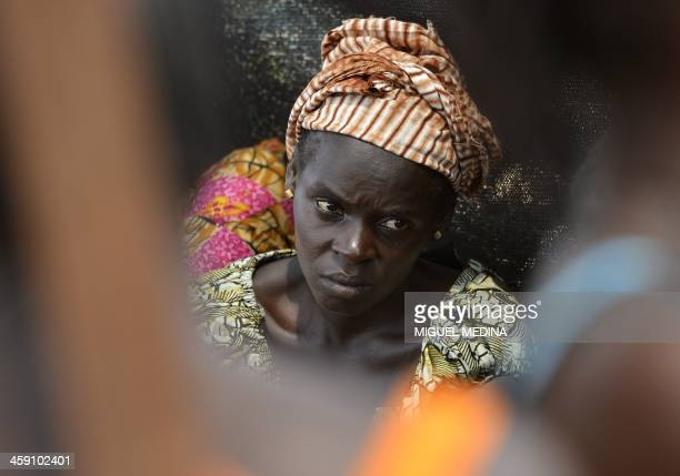 A woman looks on as internallydisplaced people wait for medical attention at the 'Medecins sans Frontieres' hospital based in the IDP camp near the...