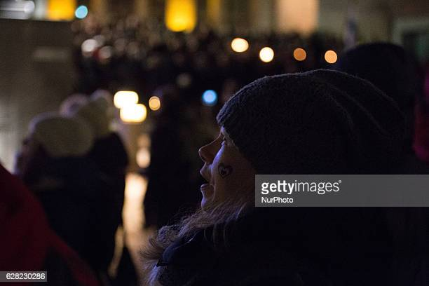 A woman looks on as thousands of people gather at the central square of the city of Tampere Finland to celebrate Finlands 99th Independence Day on...