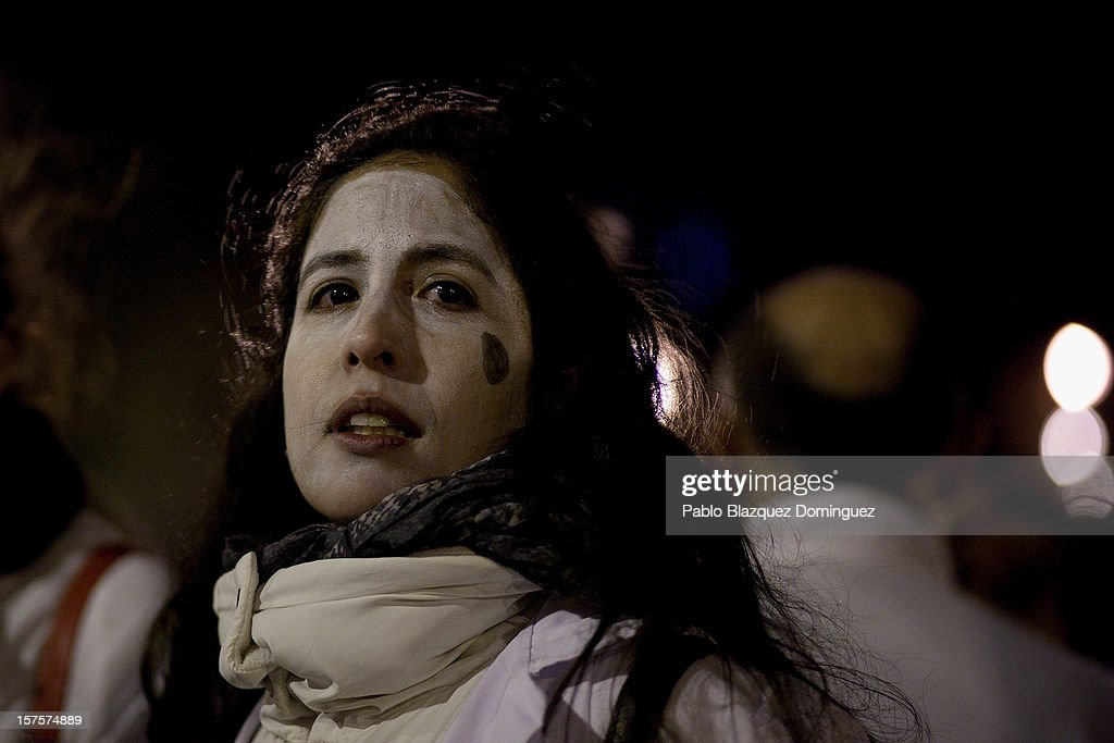 A woman looks on during a demonstration at Puente de Toledo on December 4, 2012 in Madrid, Spain. All trade unions called for the second 48 hours health workers' general strike in Madrid region, after Regional Government announced severe cuts and privatization of Medical Centers.
