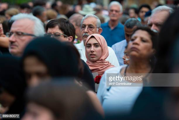 A woman looks on during a vigil in Sterling Virginia on June 21 for Nabra Hassanen The 17yearold Muslim girl was killed with a baseball bat in a road...