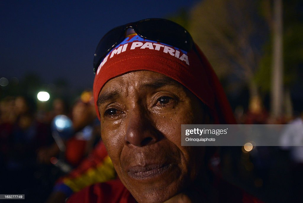 A woman looks on during the march of the supporters of President Hugo Chavez through the streets of Caracas to the military academy on March 06, 2013 in Caracas, Venezuela.