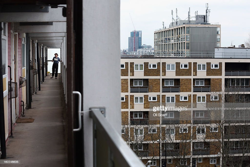 A woman looks out from a residential development in the London borough of Tower Hamlets on February 21, 2013 in London, England. A recent study has shown that 42 per cent of children in Tower Hamlets live in poverty, making it the worst area of the UK for child poverty. The research was carried out by the 'Campaign to End Child Poverty' who have produced a map describing levels of child poverty across the UK.