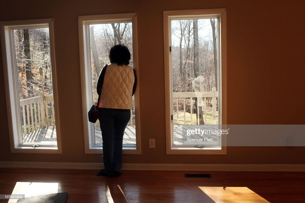 A woman looks out of the window of a foreclosed home on November 21, 2010 in Oxford, Connecticut. The home was one of numerous foreclosed homes on a bus tour organized by realtor Frank Hoinsky. Hoinsky has given over five tours which last for approximately three hours and stop at foreclosed homes in the lower Naugatuck Valley in Connecticut. As the American economy continues to struggle, housing prices are at an all-time low. Currently an estimated 1.65 million homes are in the foreclosure process in America and the Federal Reserve has announced that it expects about 4.25 million more foreclosure filings through 2012.