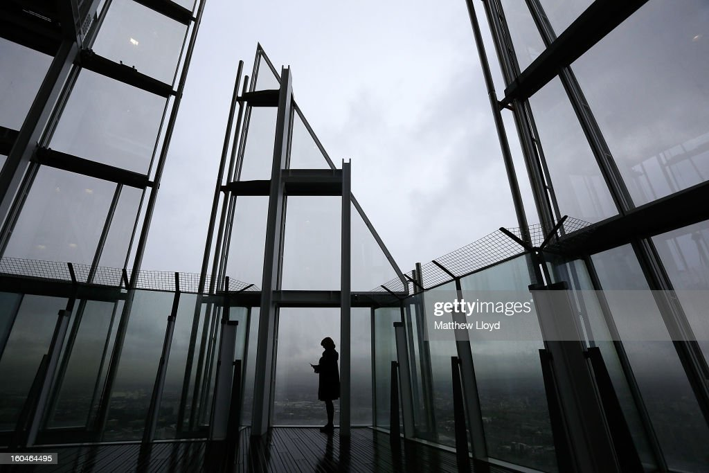 A woman looks out over London from the View from the Shard on it's opening morning on February 1, 2013 in London, England. Level 72 is the highest viewing gallery in The View from The Shard, and the highest vantage point in Western Europe.