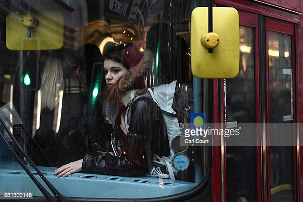 A woman looks out through a window on a crowded bus at Victoria Station on January 9 2017 in London England Millions of people are facing severe...