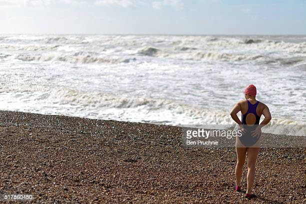 A woman looks out to sea as she prepares to go for a swim on Brighton Beach on March 28 2016 in Brighton England Yesterday the Met Office issued an...
